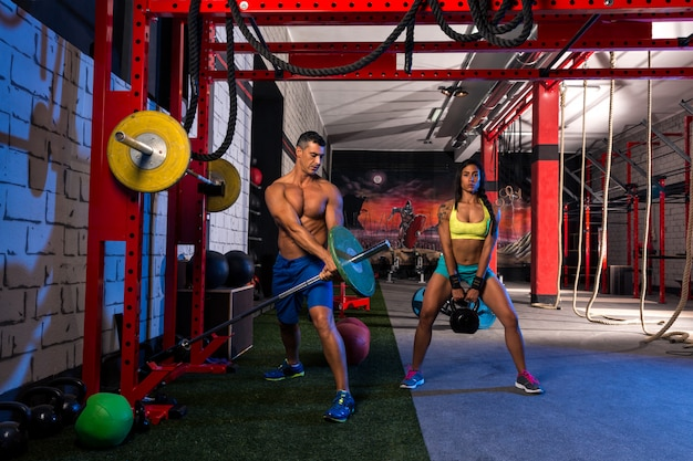 Woman man gym group weightlifting workout Premium Photo