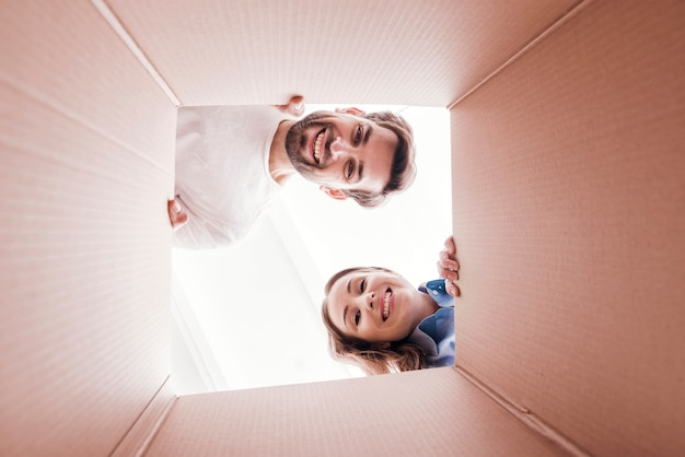 Woman and man inside bottom of the box view Free Photo