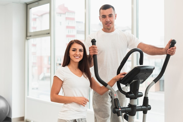 Woman and man using stepper Free Photo