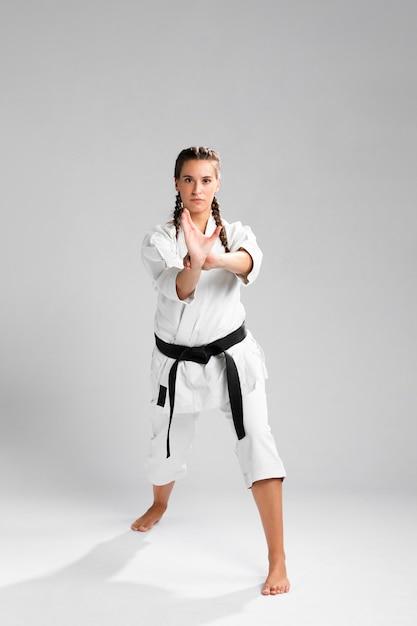Woman in martial arts uniform exercising karate Free Photo