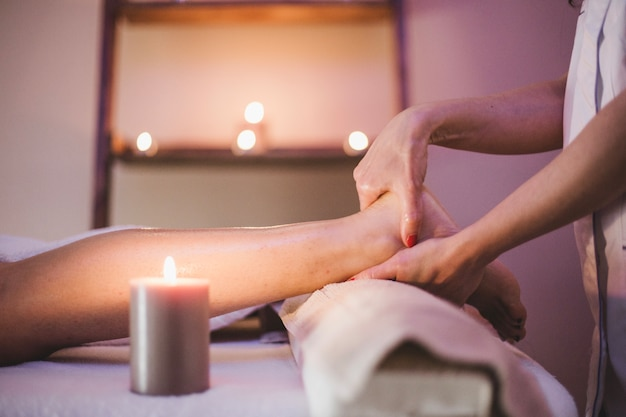 Woman massaging client's feet Free Photo