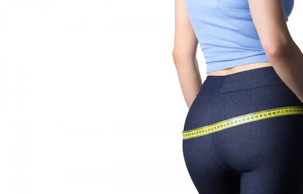 Woman measuring her hips Premium Photo