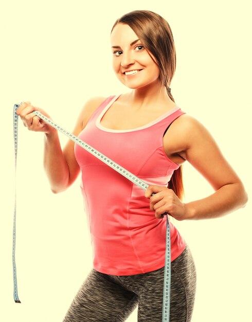 Woman measuring her waistline . perfect slim body Premium Photo