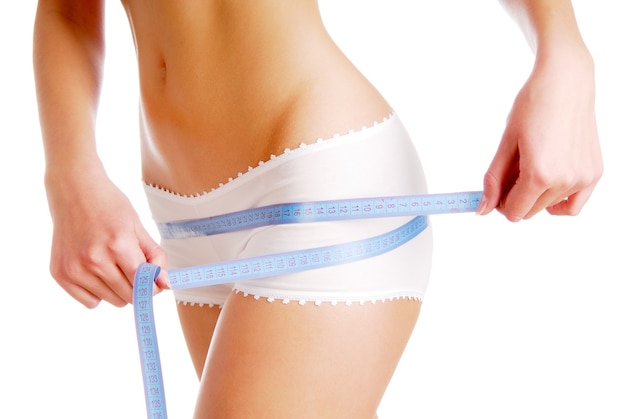 Woman measuring perfect shape of beautiful hips Free Photo