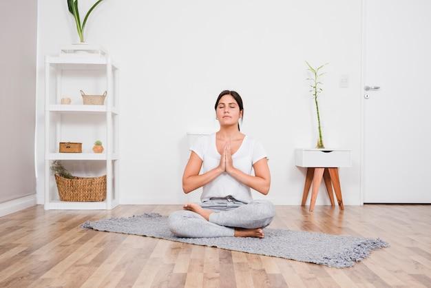 Woman meditating at home Free Photo
