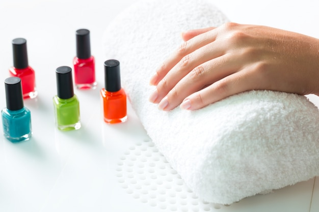 Woman in nail salon receiving manicure Premium Photo