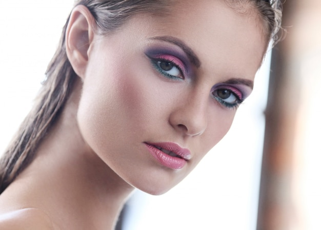Woman in natural makeup commercial with pink eyeshadow Free Photo