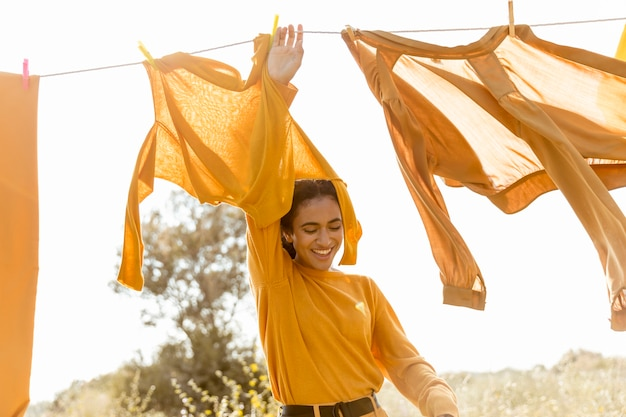 Woman in nature with clothesline Free Photo