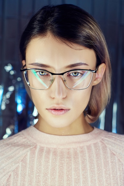 Woman in neon colored reflection glasses, makeup Premium Photo