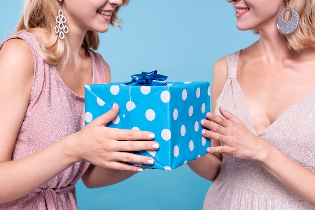 Woman offering a mysterious gift Free Photo