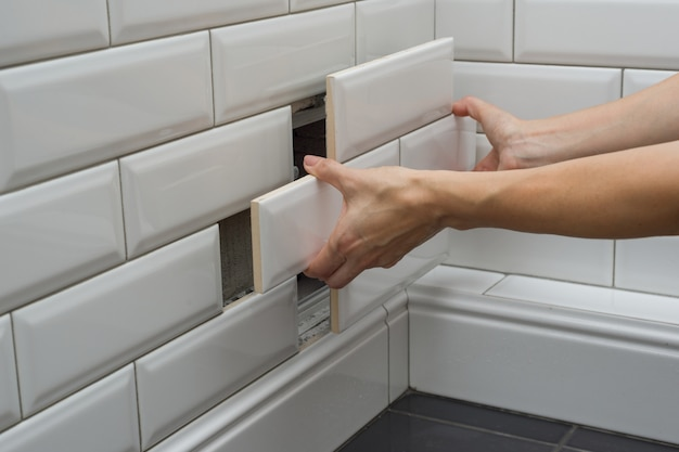 Woman opens, closes the hidden revision sanitary hatch Premium Photo