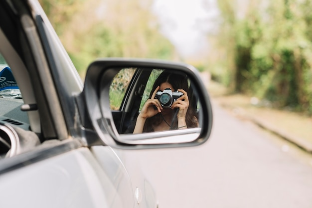 Woman out of car window Free Photo