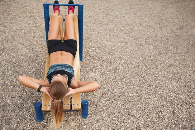 Woman outdoor workout sit ups Free Photo