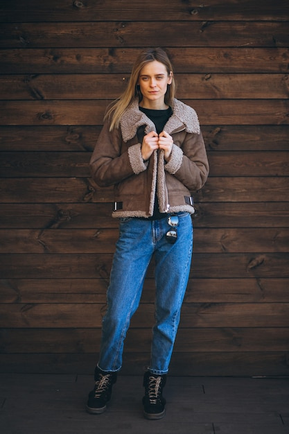Woman outside on the wooden background Free Photo