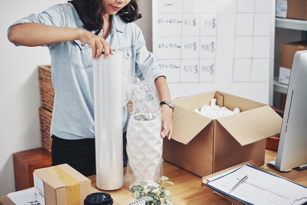 Woman packing order in box Free Photo