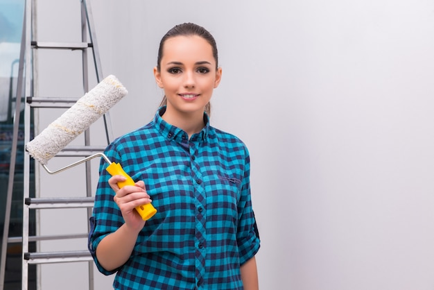 Woman painting house in diy concept Premium Photo
