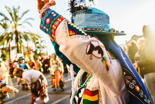 Woman performing the bolivian folk dance the tinku dressed in folkloric and colorful traditional dress Premium Photo