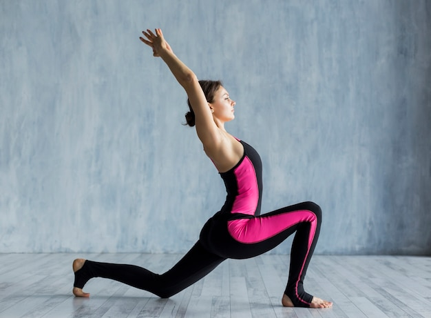Woman performing a lunge exercise Free Photo