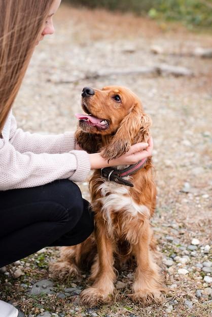 Woman petting adorable dog Free Photo