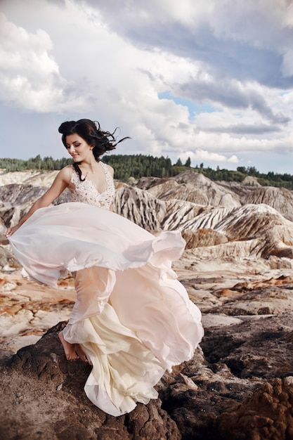 Woman in pink dress in the fabulous mountains Premium Photo