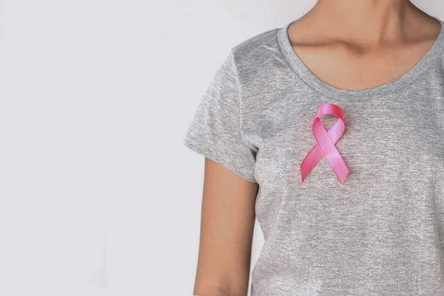 Woman pink ribbon breast cancer awareness. Premium Photo