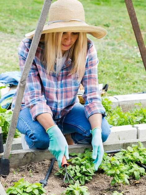 Woman planting in her garden Free Photo