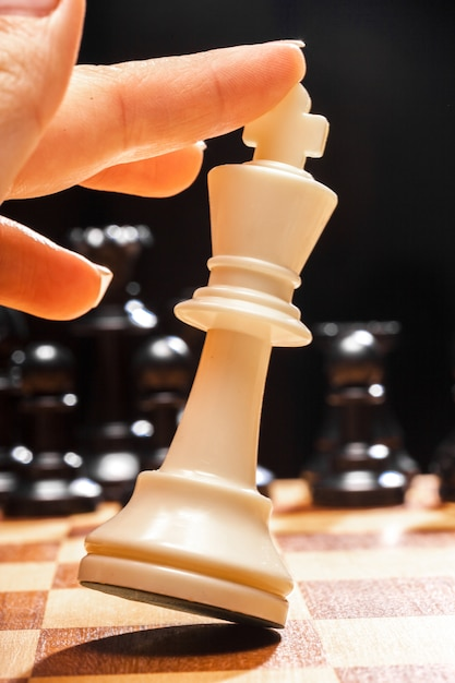 Woman playing chess Premium Photo