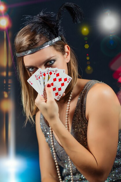Woman playing poker with scale Premium Photo