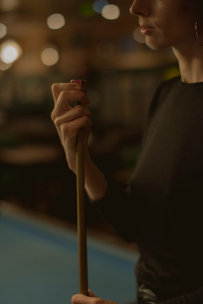 Woman playing pool at a bar Free Photo