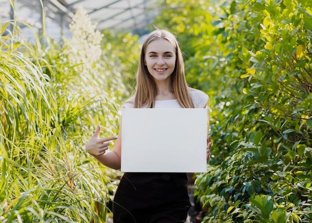 Woman pointing at blank sheet Free Photo