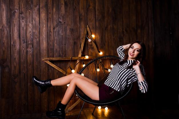 Woman posing against light star Premium Photo
