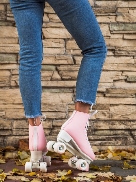 Woman posing in jeans with roller skates Free Photo