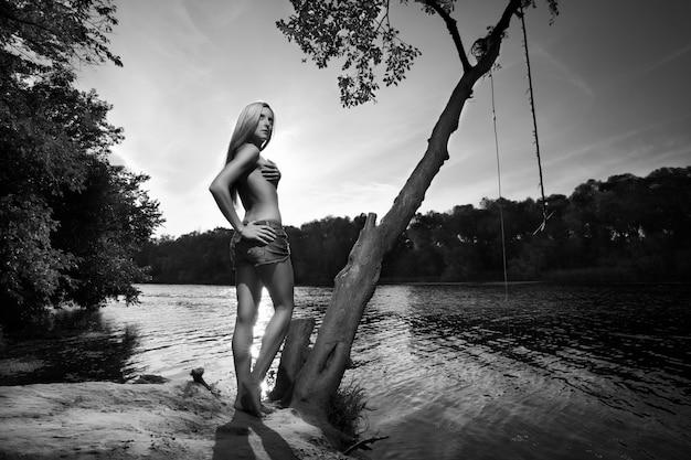 Woman posing near a lake Free Photo
