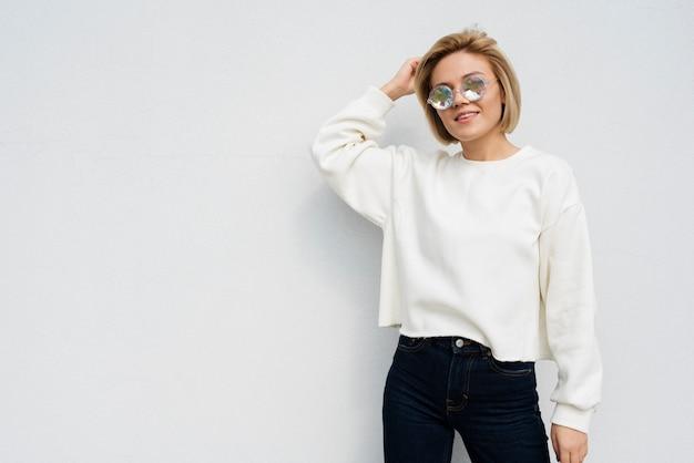 Woman posing on plain background Free Photo