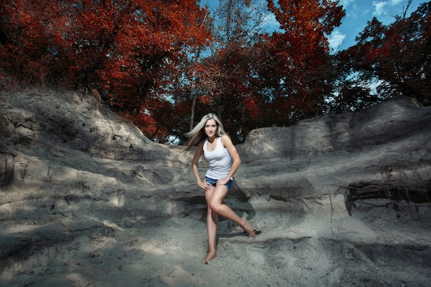 Woman posing on the rocks in a forest Free Photo