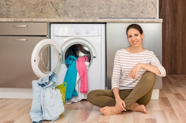 Woman Posing Next To Washing Machine Free Photo