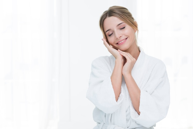 Woman posing with bathrobe in a spa Premium Photo