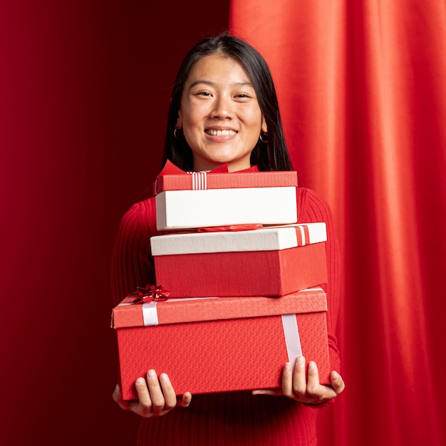 Woman posing with gift boxes for chinese new year Free Photo