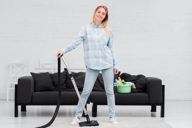 Woman posing with vacuum cleaner Premium Photo