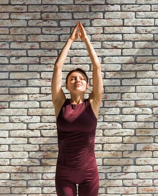 Woman practicing an upward salute Free Photo