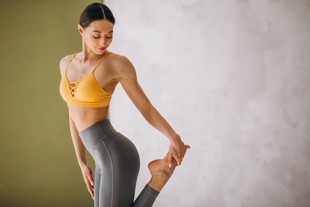Woman practising yoga Free Photo