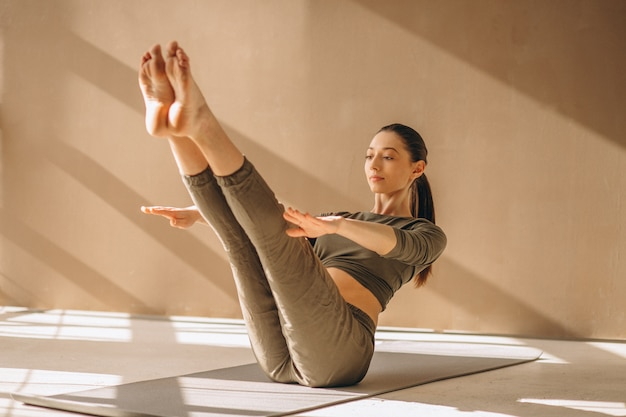 Woman practising yoga Free Photo