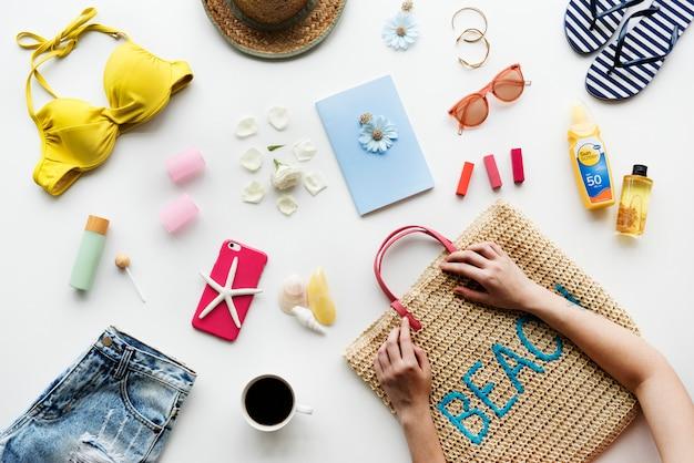 Woman prepare stuff for summer beach Premium Photo