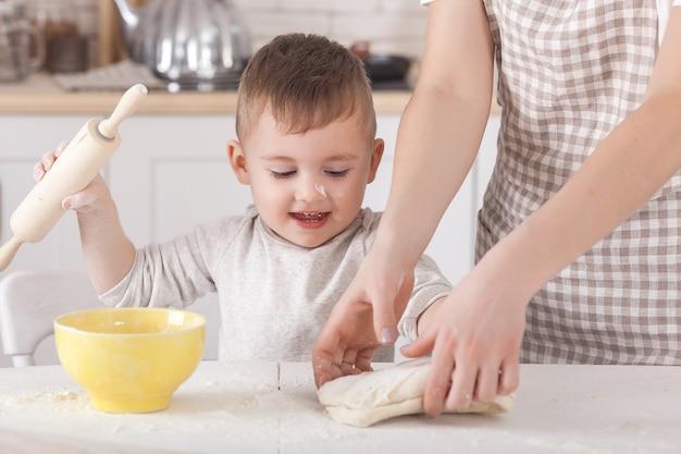 Woman preparing the dough. closeup still of woman`s hands with daugh and flour. italian food preparing process. Premium Photo