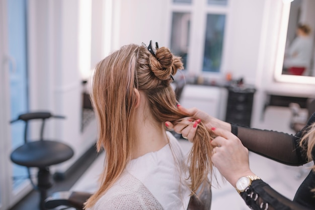 Woman preparing hair of client for styling Free Photo