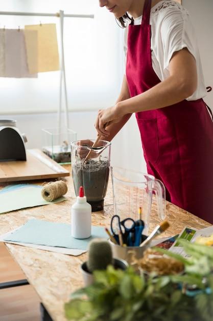 Woman preparing paper pulp in blender Free Photo