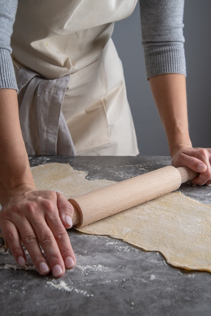 Woman pressing pasta dough Free Photo