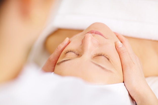 Woman under professional facial massage in beauty spa Premium Photo