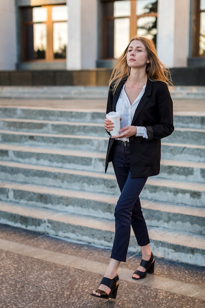 Woman proudly walking away Free Photo