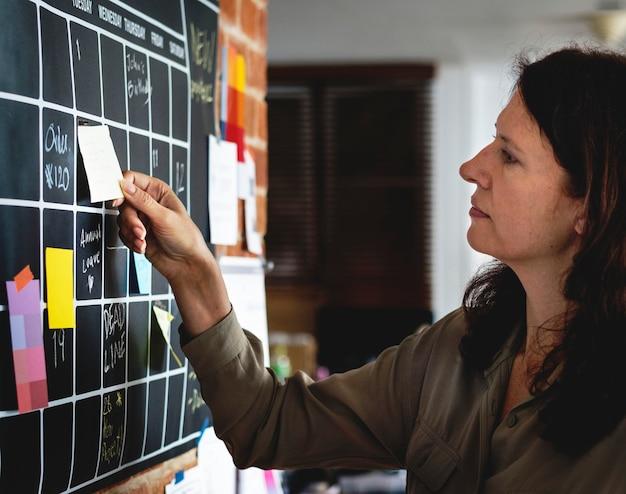 Woman pulling sticky note Premium Photo